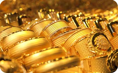 gold bangles and buckles in a jewelry display
